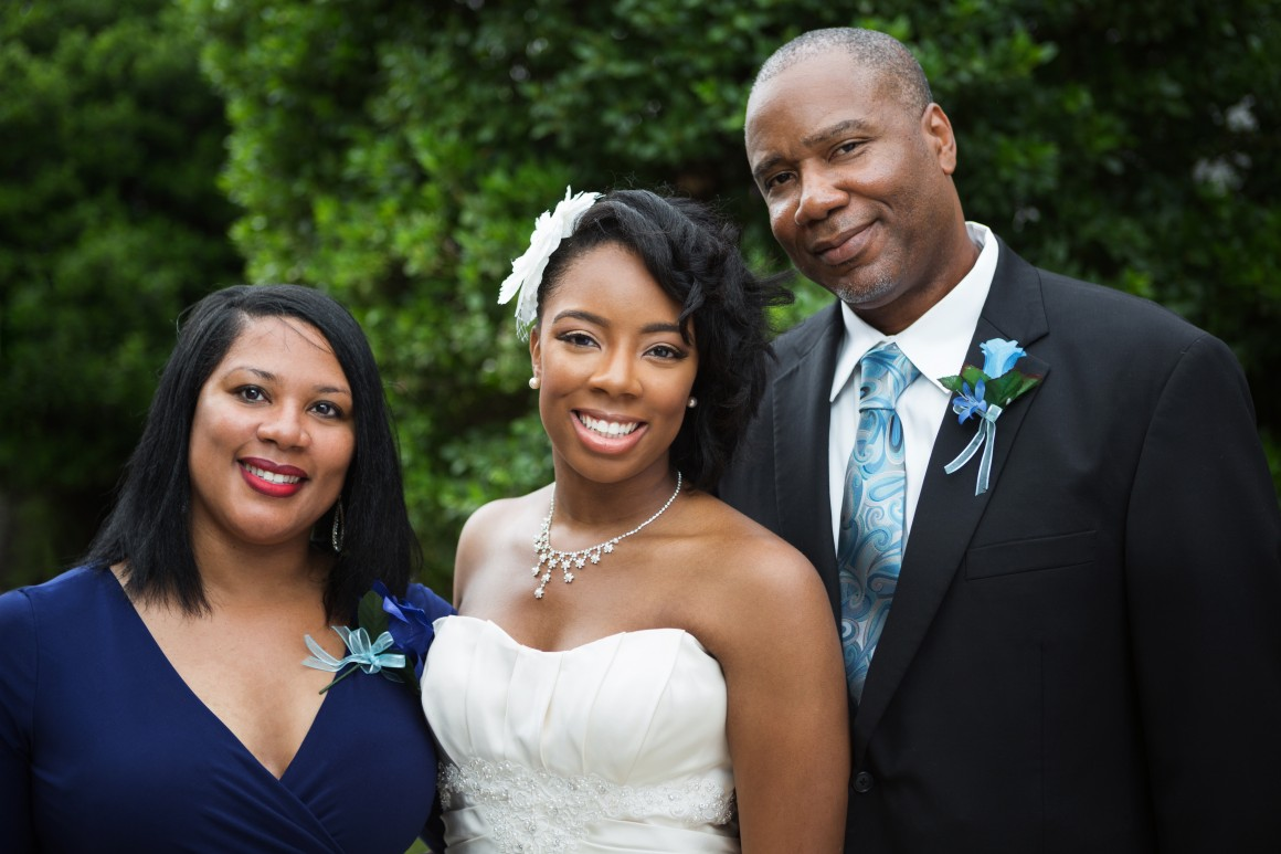 Bride and her parents on wedding day