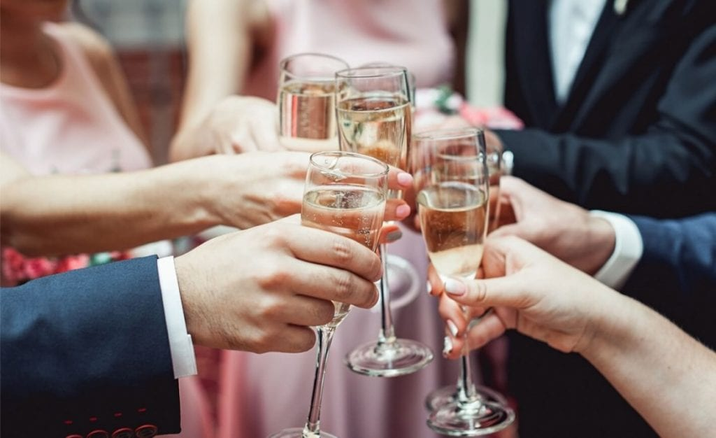 Guests clinking champagne flutes