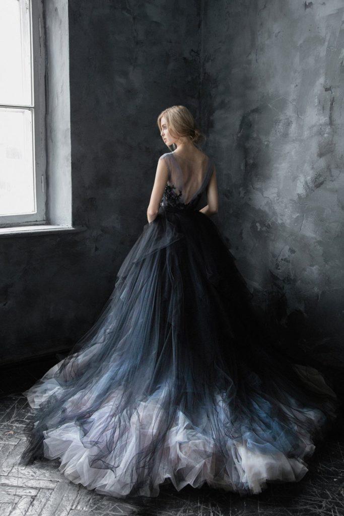 Bride wearing a stunning black ombre ballgown wedding dress