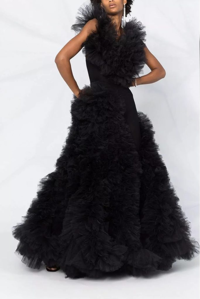 african american woman modeling dramatic black wedding dress with layers of tulle