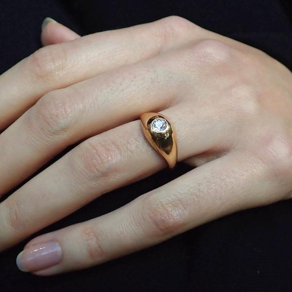Gypsy set engagement ring