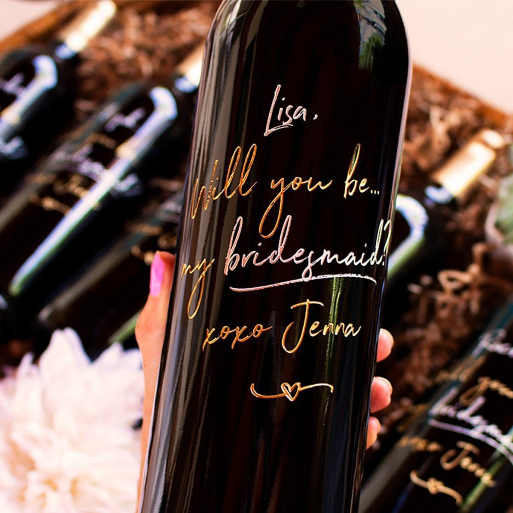 """Bottles of Cabernet Sauvignon etched with """"will you be my bridesmaid"""""""