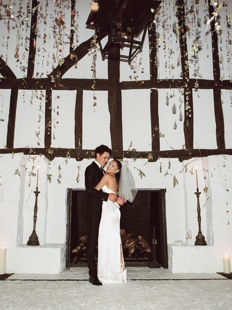 Ariana Grande hugging groom after wedding ceremony