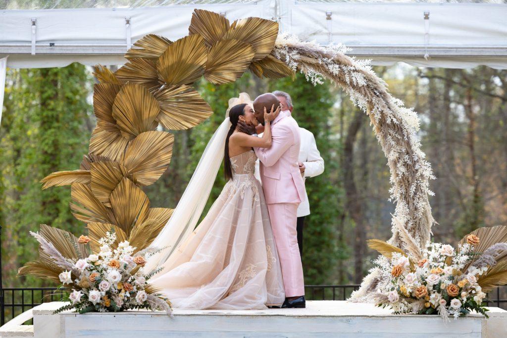 Jeannie Mai kissing Jeezy at altar on wedding day