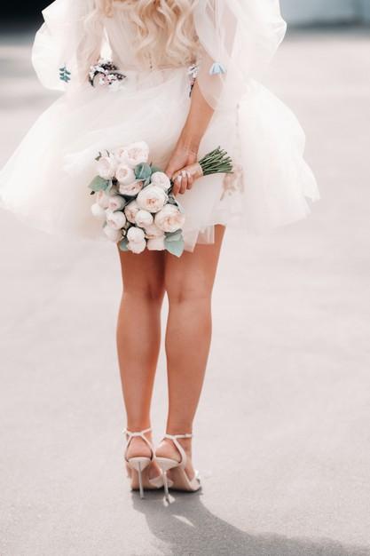 Bride wearing short & Sassy  tulle wedding dress