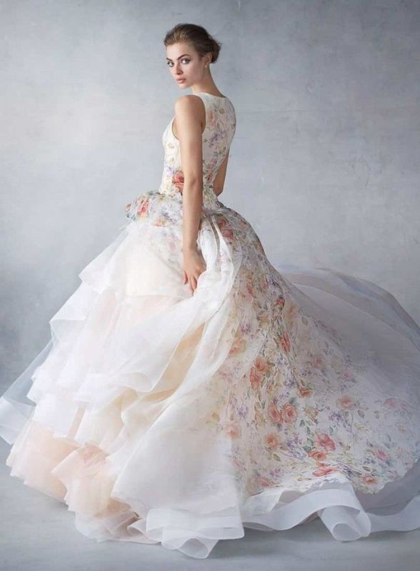 Bride twirling in organza ballgown wedding dress with beautiful romantic floral print