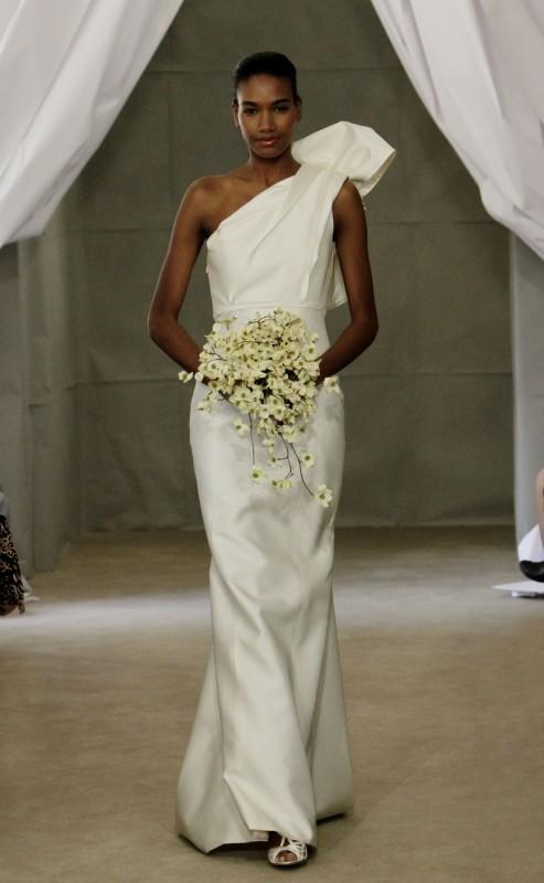 Beautiful African American model wearing sophisticated one shoulder wedding dress