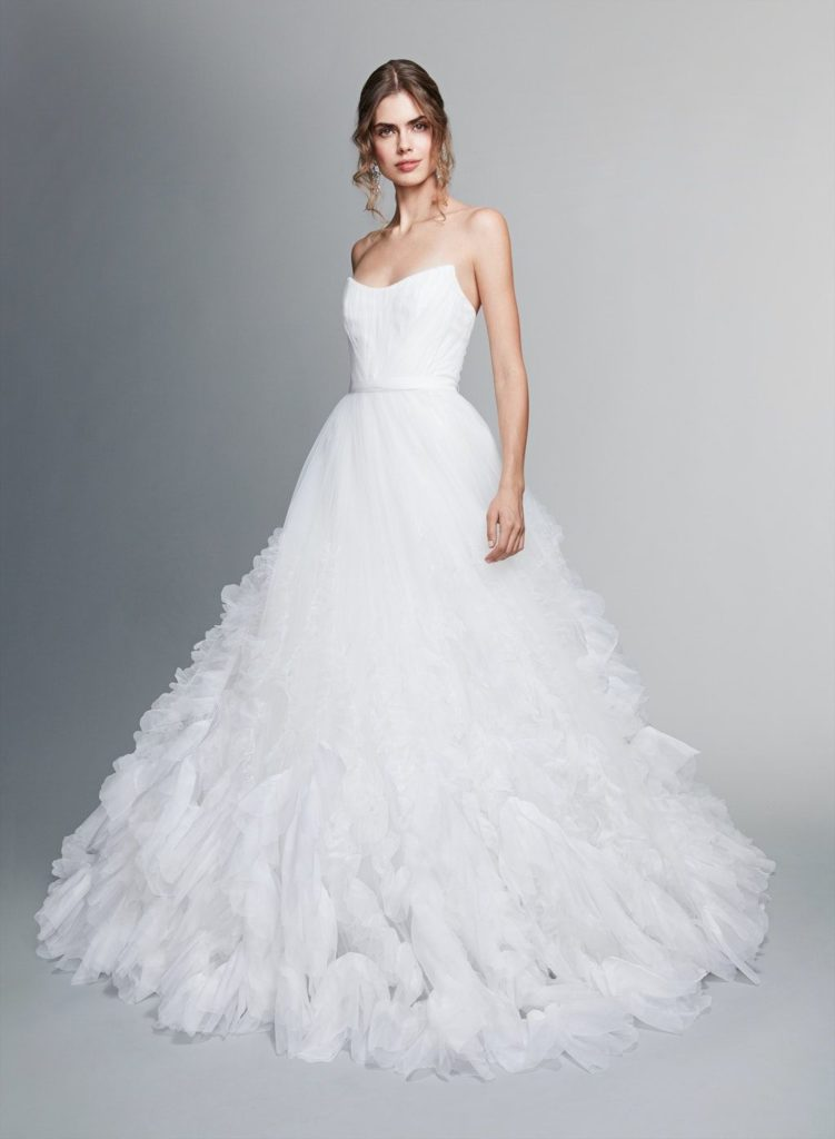 Woman wearing Marchesa Notte a simple and dramatic wedding dress