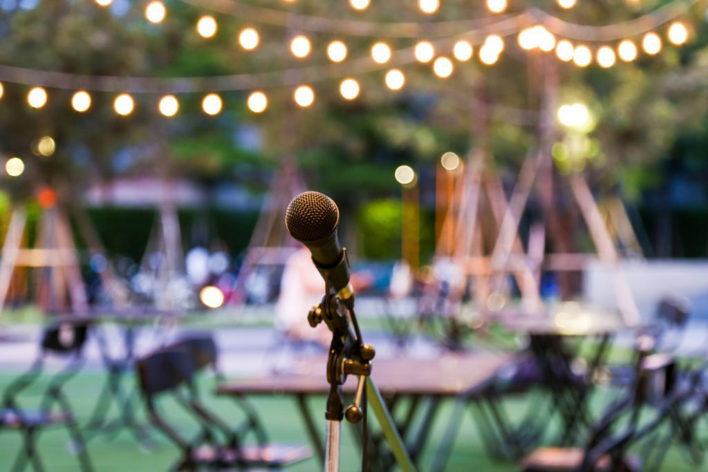 Microphone set up on stage at outdoor wedding
