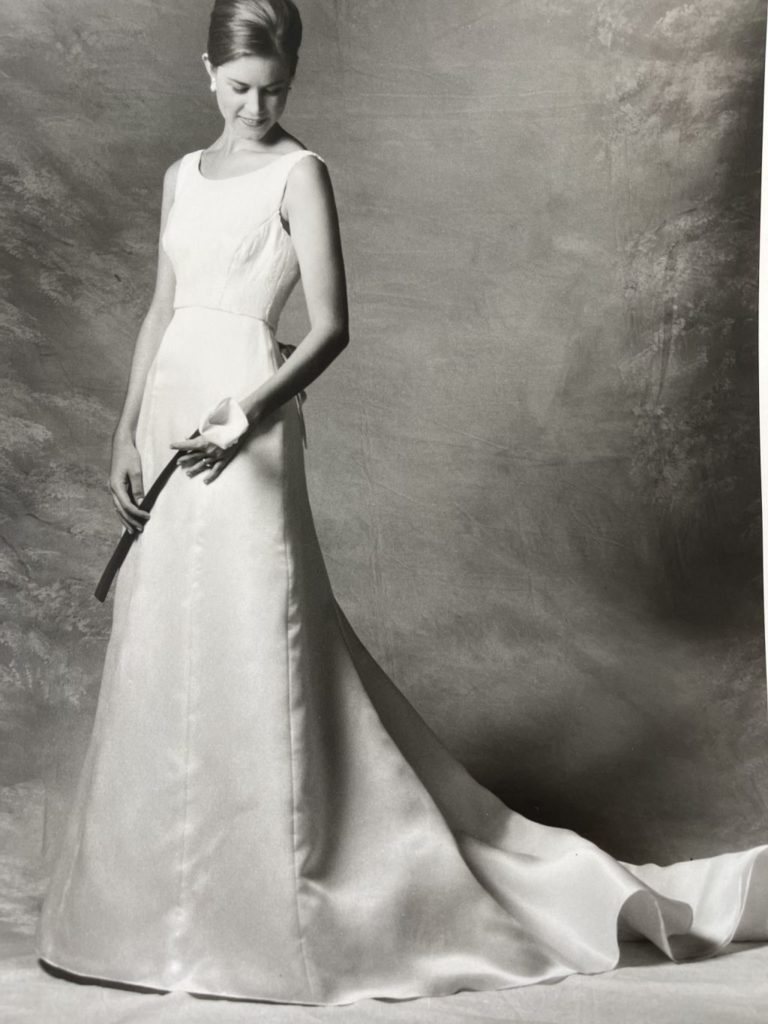Black and white photo of bride wearing sophisticated Audrey Hepburn inspired wedding gown