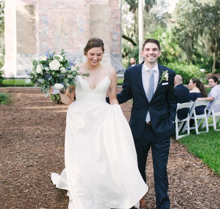Bride and Groom walking down aisle after outdoor wedding ceremony